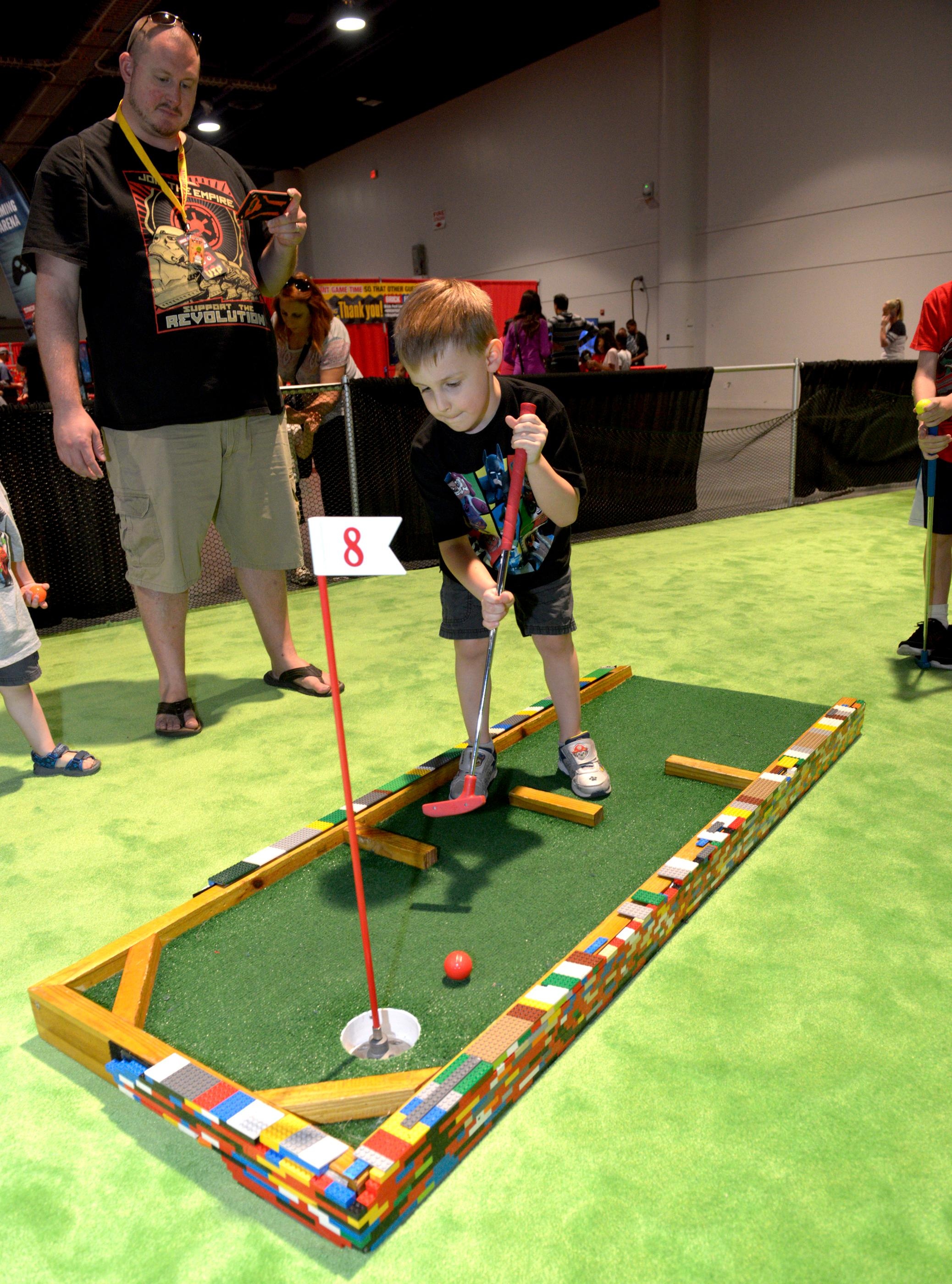Kids get to play miniature golf during the Brick Fest Live Lego Fan Experience at the Las Vegas Convention Center, September 9, 2017. [Glenn Pinkerton/Las Vegas News Bureau]
