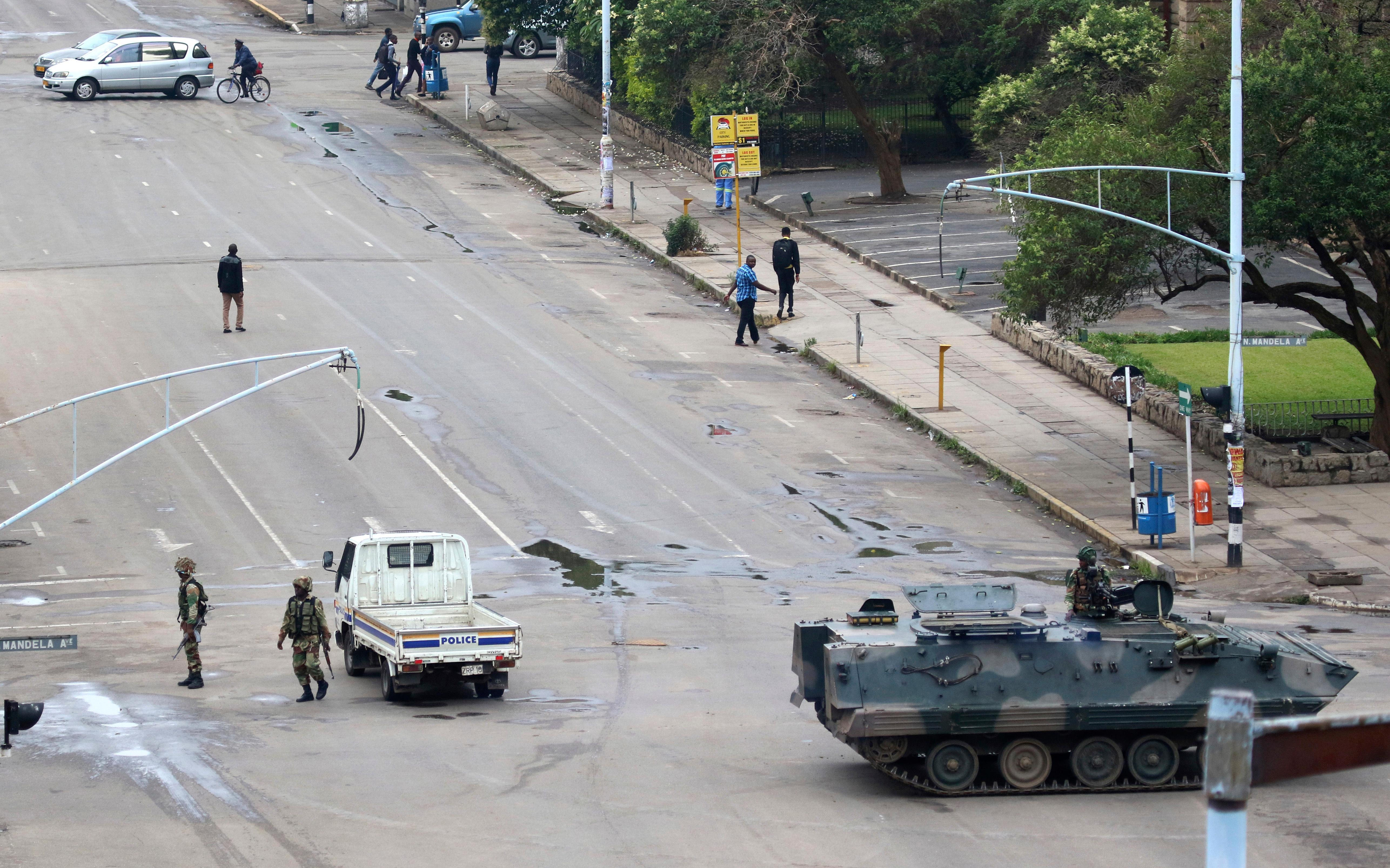 Armed soldiers patrol a street in Harare, Zimbabwe, Wednesday, Nov. 15, 2017. Zimbabwe's army said Wednesday it has President Robert Mugabe and his wife in custody and is securing government offices and patrolling the capital's streets following a night of unrest that included a military takeover of the state broadcaster. (AP Photo)