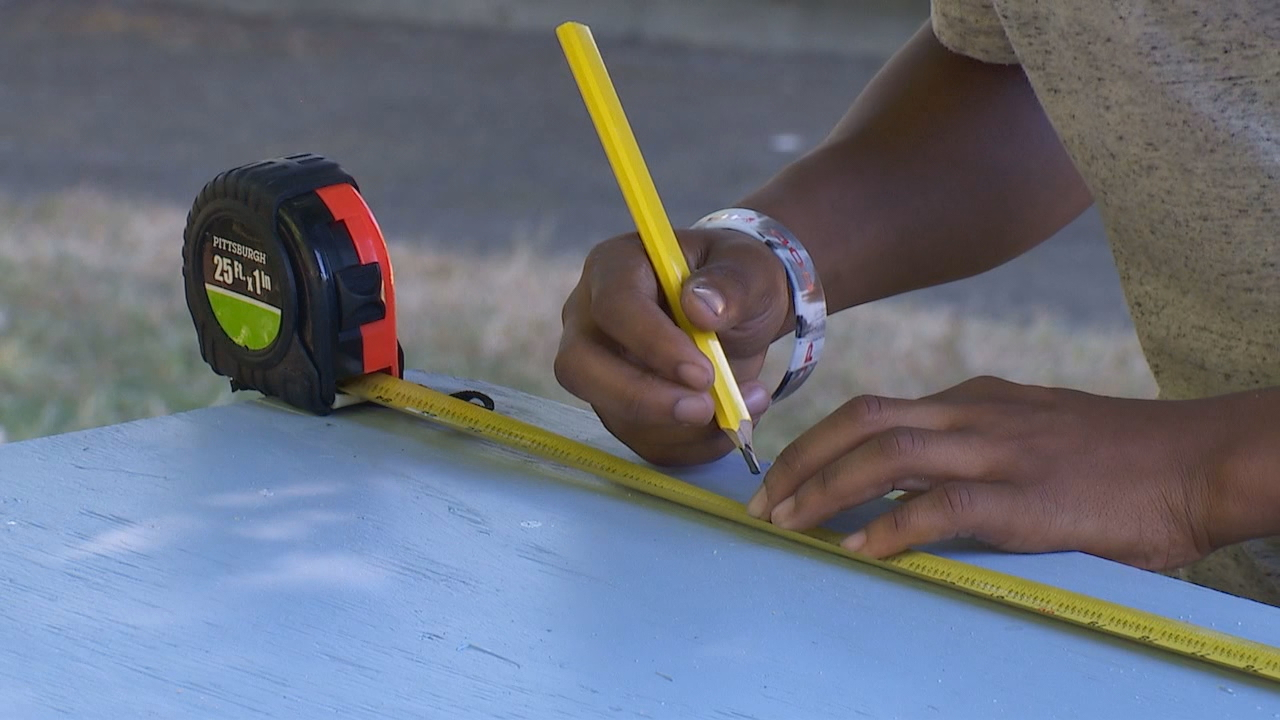 Volunteers along with kids at a Seattle-area summer camp came together Wednesday to help the homeless.