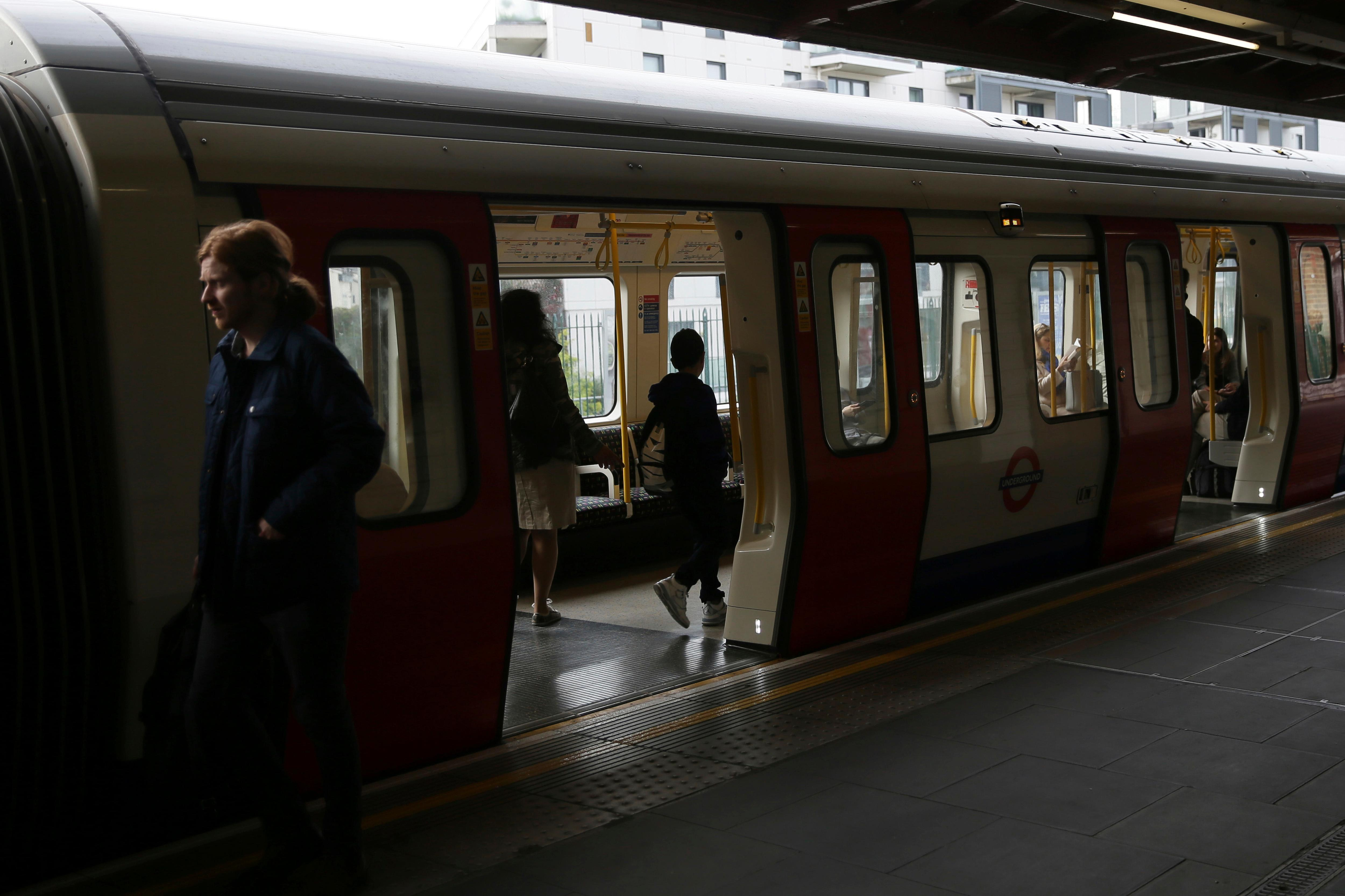 Passengers board a train at Parsons Green subway station after it was reopened following a terrorist attack on a train at the station yesterday in London, Saturday Sept. 16, 2017. British authorities are searching for suspects in the London subway blast that injured more than two dozen people as hundreds of soldiers are being deployed across the country. (AP Photo/Tim Ireland)