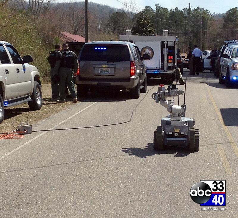 The Oxford Police Department SWAT Team uses its robot at the scene of a standoff with a suspected burglar in Jacksonville, Ala., Tuesday, March 12, 2014.