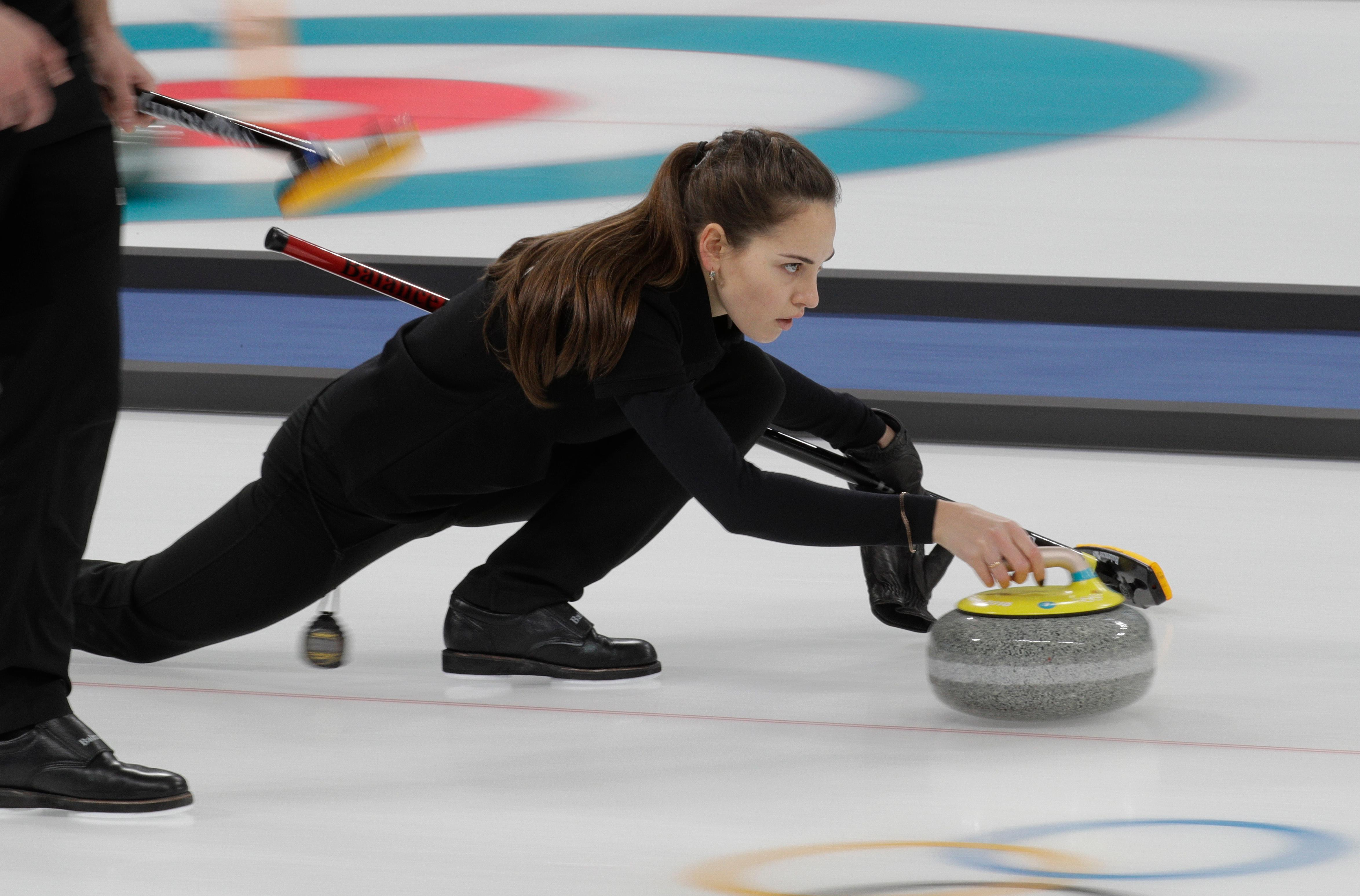 Olympic Athlete from Russia curler Anastasia Bryzgalova prepares to throw her stone during the mixed doubles training session ahead of the 2018 Winter Olympics in Gangneung, South Korea, Wednesday, Feb. 7, 2018. (AP Photo/Aaron Favila)