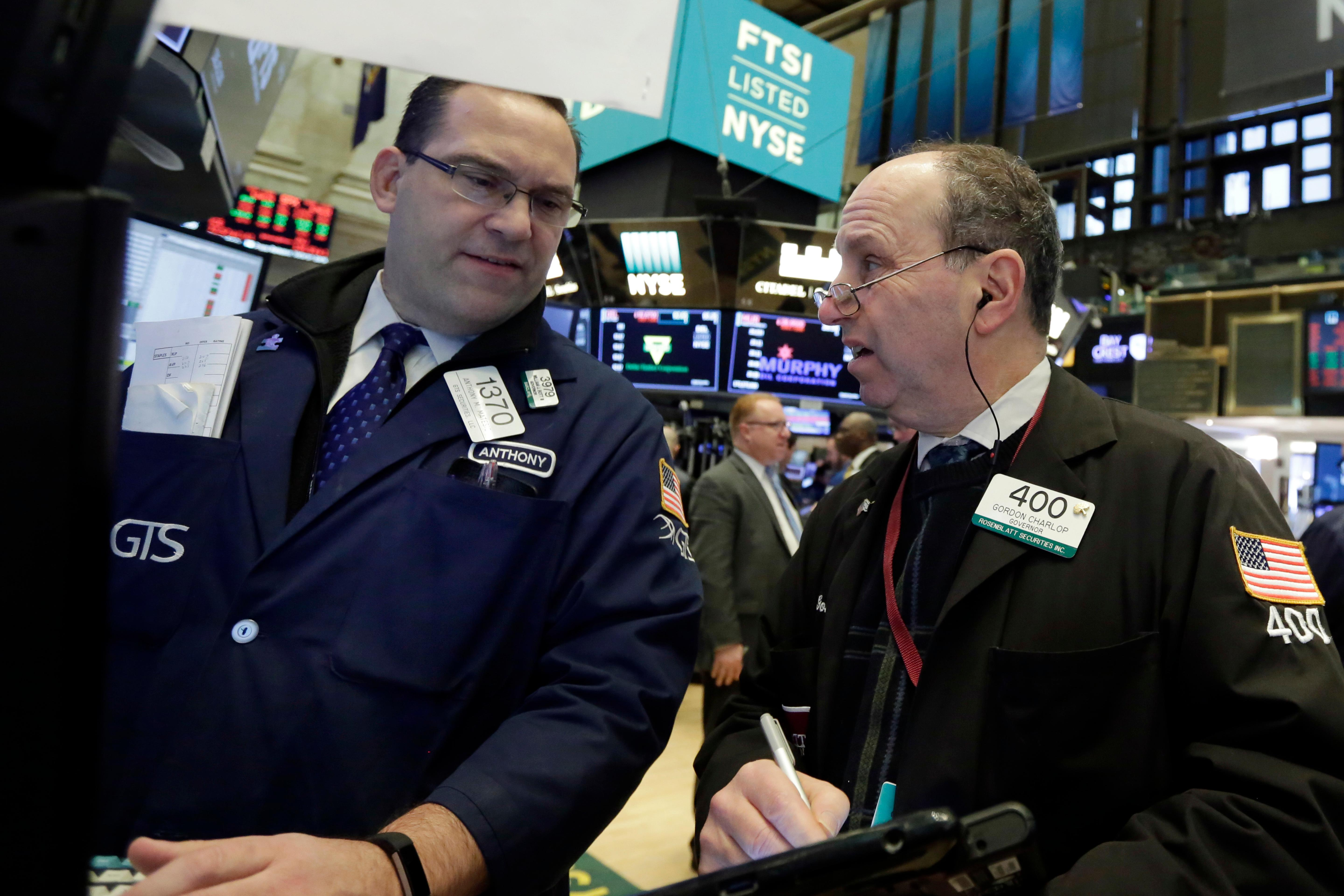 Specialist Anthony Matesic, left, and trader Gordon Charlop work on the floor of the New York Stock Exchange, Monday, Feb. 5, 2018. Stock markets around the world took another pummeling Monday as investors continued to fret over rising U.S. bond yields. (AP Photo/Richard Drew)