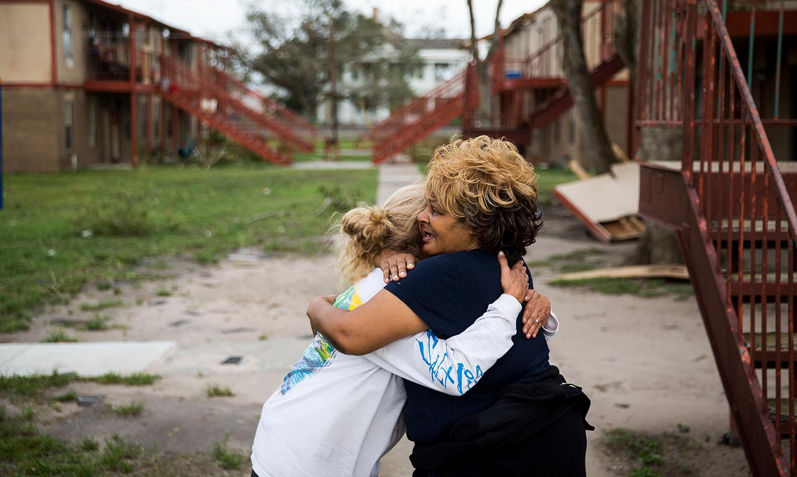 "Genice Gipson hugs her lifelong friend, Loretta Capistran, outside of Capistran's apartment complex in Refugio, Texas, on Monday, Aug. 28, 2017. ""We got to be strong, baby,"" Gipson told Capistran. (Nick Wagner/Austin American-Statesman via AP)"