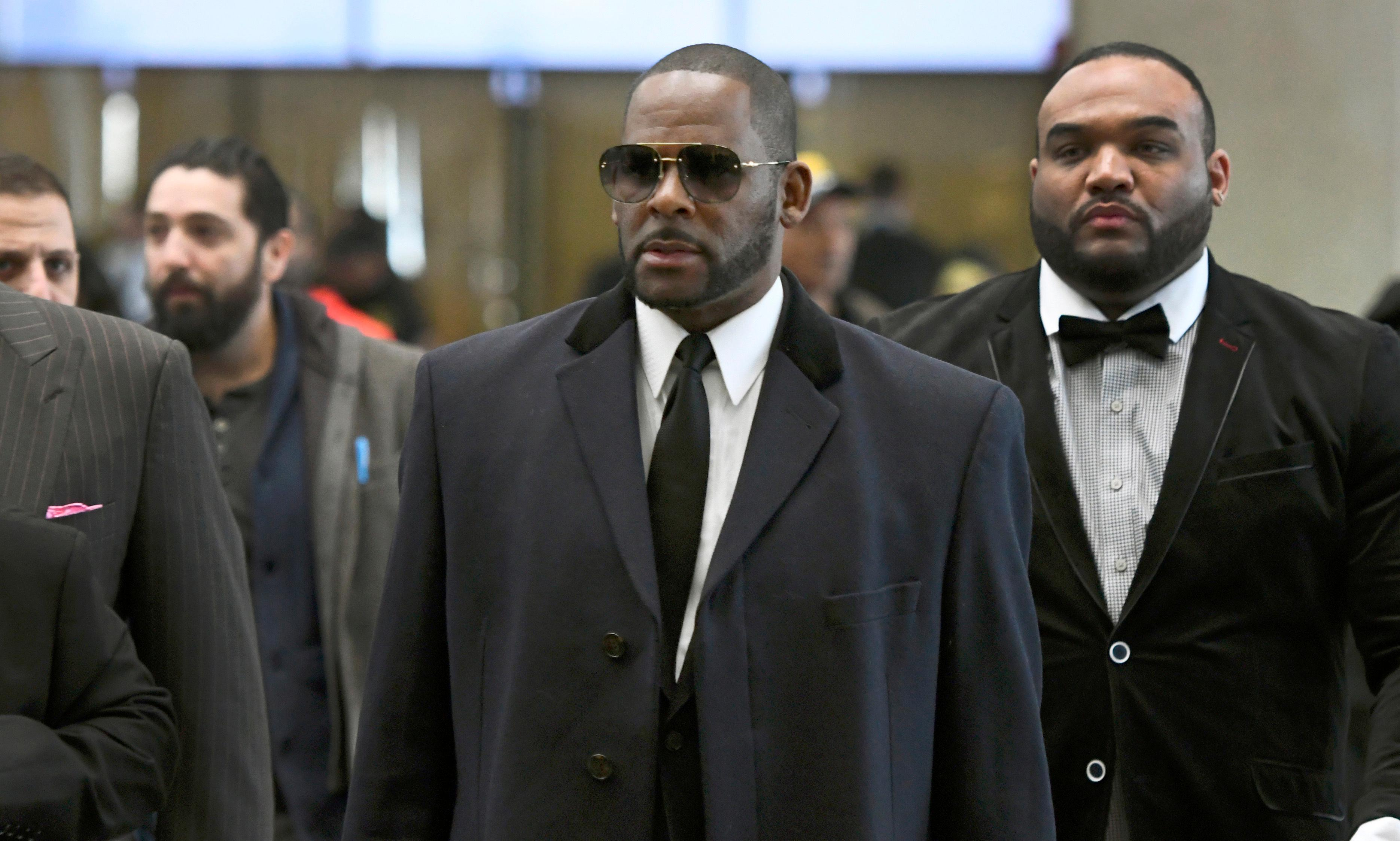 FILE - In this May 7, 2019 file photo, Musician R. Kelly, center, arrives at the Leighton Criminal Court building for a hearing in Chicago. (AP Photo/Matt Marton, File)