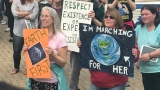 Protesters march in Augusta for climate action