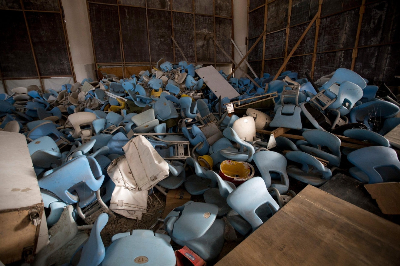 This Feb. 2, 2017 photo shows seats jumbled in a pile inside Maracana stadium in Rio de Janeiro, Brazil. The historic stadium, site of the opening and closing ceremony, has been vandalized as stadium operators, the Rio state government, and Olympic organizers, have fought over $1 million in unpaid electricity bills and management of the venue. (AP Photo/Silvia Izquierdo)