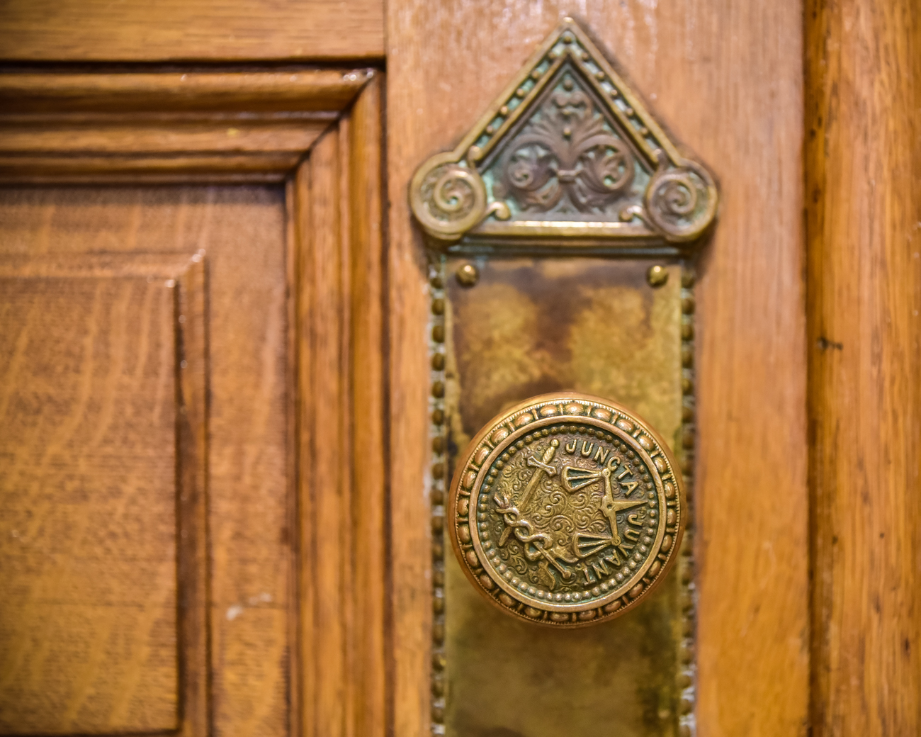 City Hall's intricate design details, such as the door knobs which feature the city's Latin slogan, Juncta Juvant, are many and spread throughout the building.  / Image: Phil Armstrong, Cincinnati Refined // Published: 1.20.17