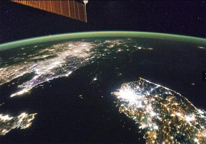 Flying over East Asia, an Expedition 38 crew member on the International Space Station took this night image of the Korean Peninsula.  (Photo & Caption: NASA)