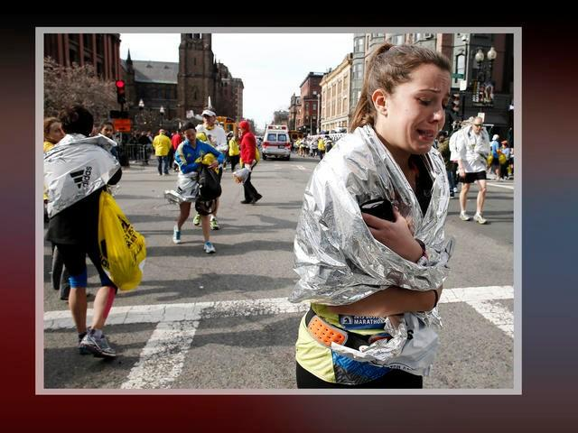 Woman runner reacts after explosions near the finish line of the 2013 Boston Marathon.