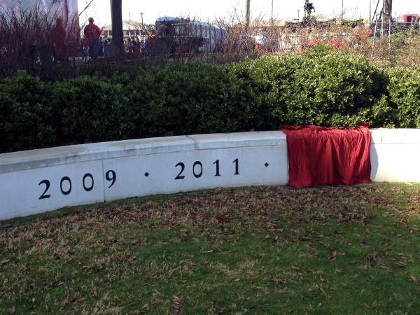 A crimson tarp cover the new '2012' national championship carving around Nick Saban's statue outside Bryant-Denny Stadium.