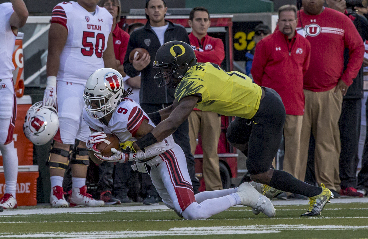 Oregon center back Arrion Springs (#1) takes down Utah wide receiver Darren Carrington II. The Oregon Ducks lead the Utah Utes 17 to six at the end of the first half on a sunny afternoon at Autzen Stadium. Photo by Ben Lonergan, Oregon News Lab