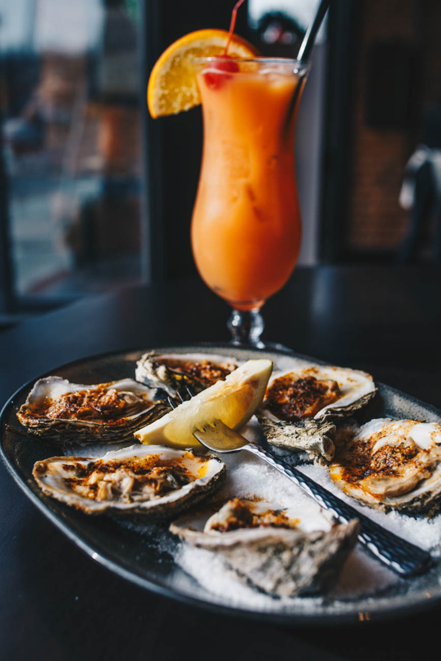 Charbroiled Oysters served with a Hurricane / Image: Catherine Viox // Published: 1.14.19