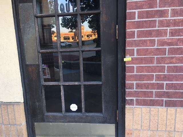 Spots where bullets hit are still marked outside the West End Tavern after an early morning shooting left one man in critical condition. (Photo: KATV)