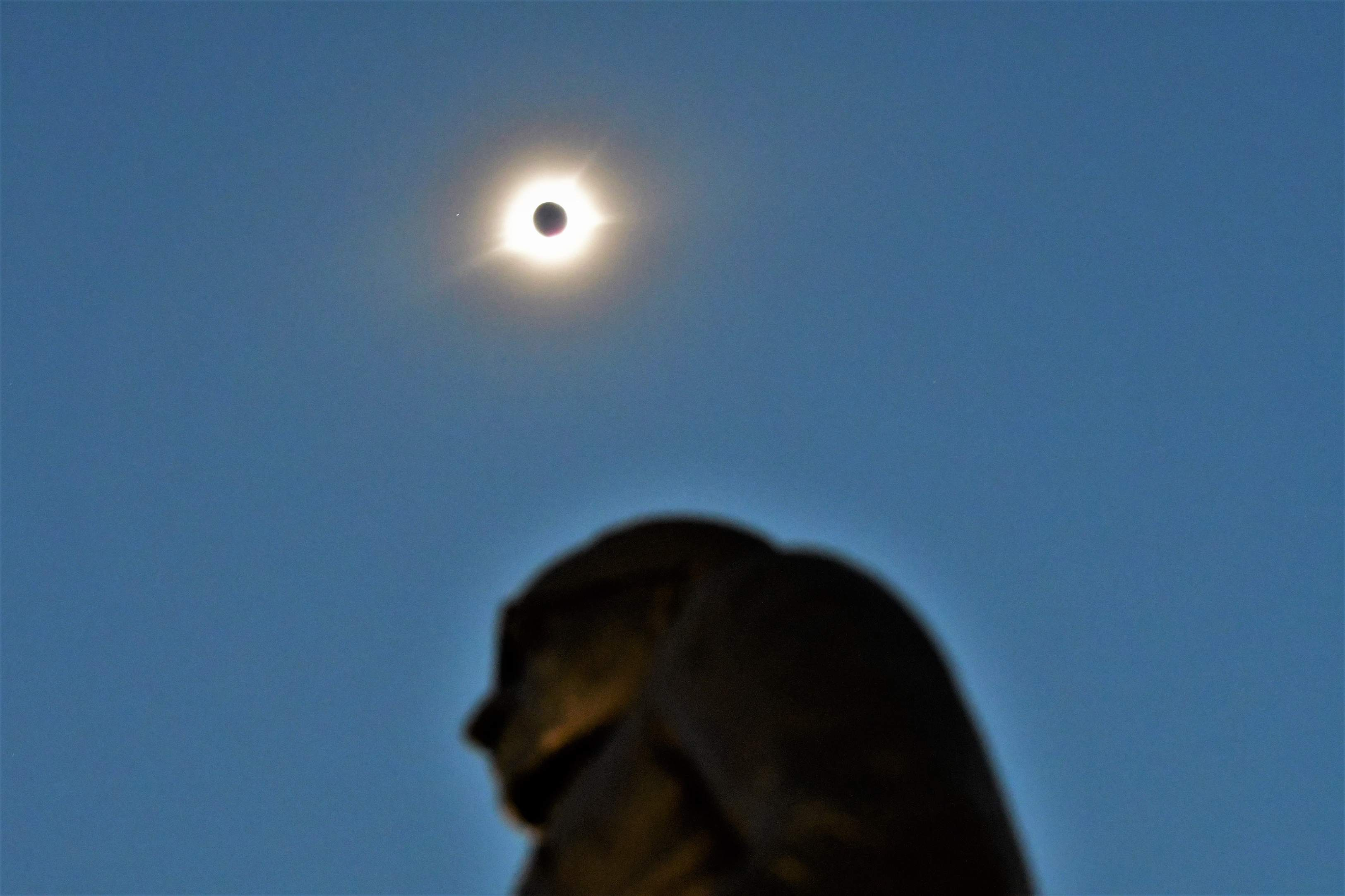 The statue of Harry Truman on Independence Square at the time of the eclipse's totality Monday. [David M. Rainey/Special to The Examiner]