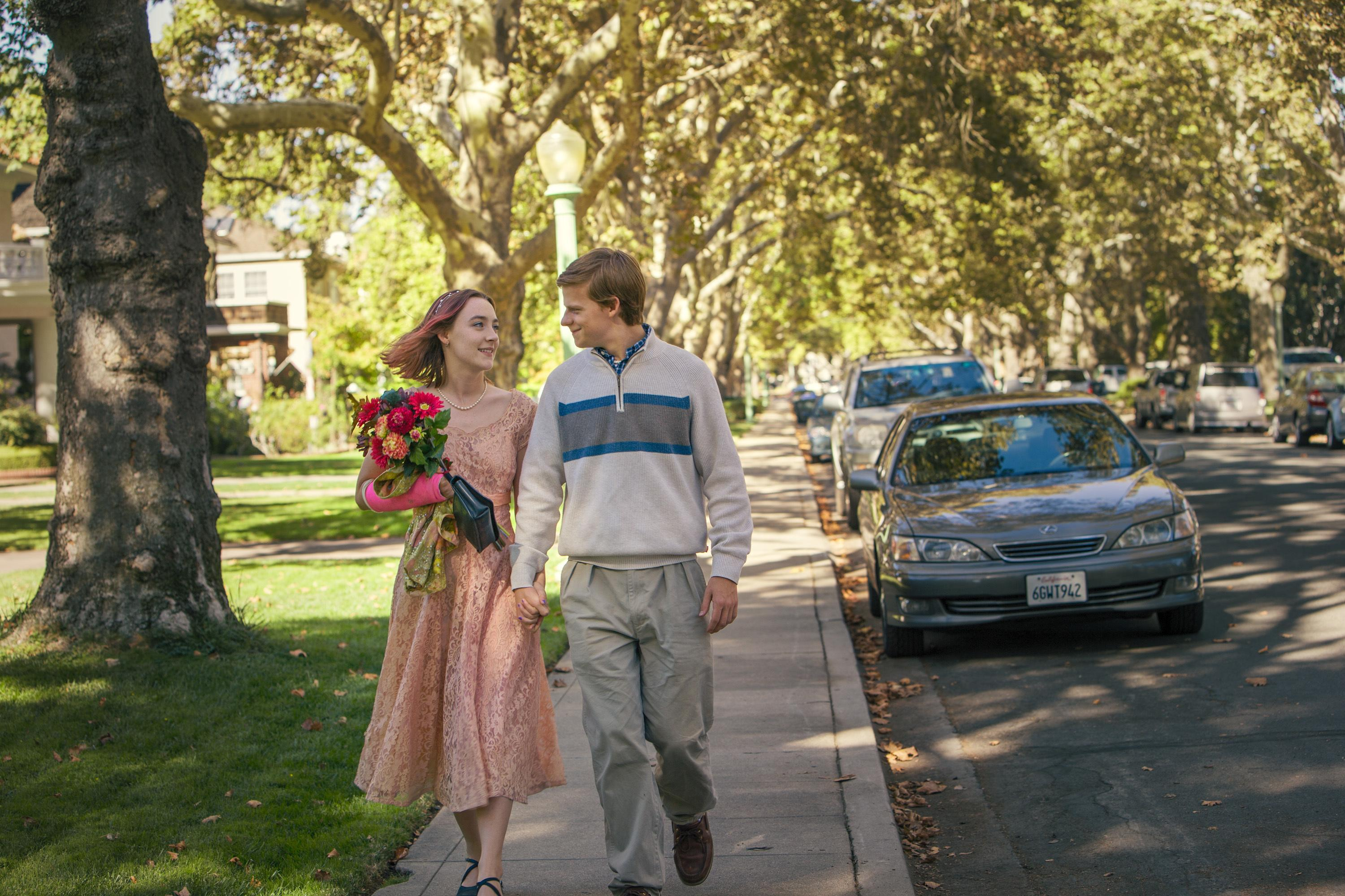 "This image released by A24 Films shows Saoirse Ronan, left, and Lucas Hedges in a scene from ""Lady Bird."" The film earned eight Critics' Choice Awards nominations on Wednesday, Dec. 6, 2017, including one for best picture. The winners will be announced at a Jan. 11 gala that will be televised on The CW Network.  (Merie Wallace/A24 via AP)"