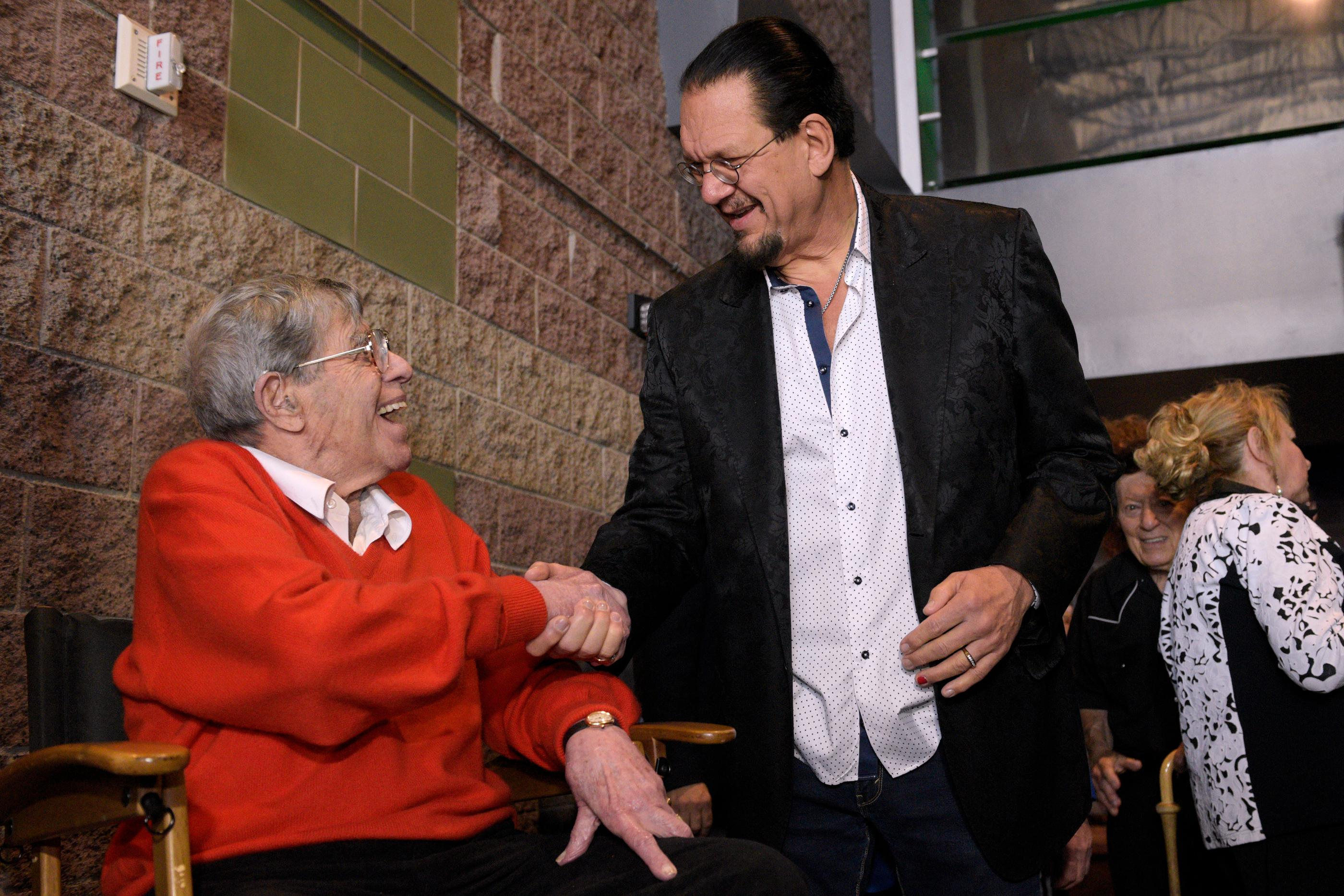 "Jerry Lewis, left, talks with Penn Jillette before a preview of his new film ""Max Rose"" Saturday, Sept. 24, 2016 at Regal Village Square Cinemas in Las Vegas. CREDIT: Sam Morris/Las Vegas News Bureau"