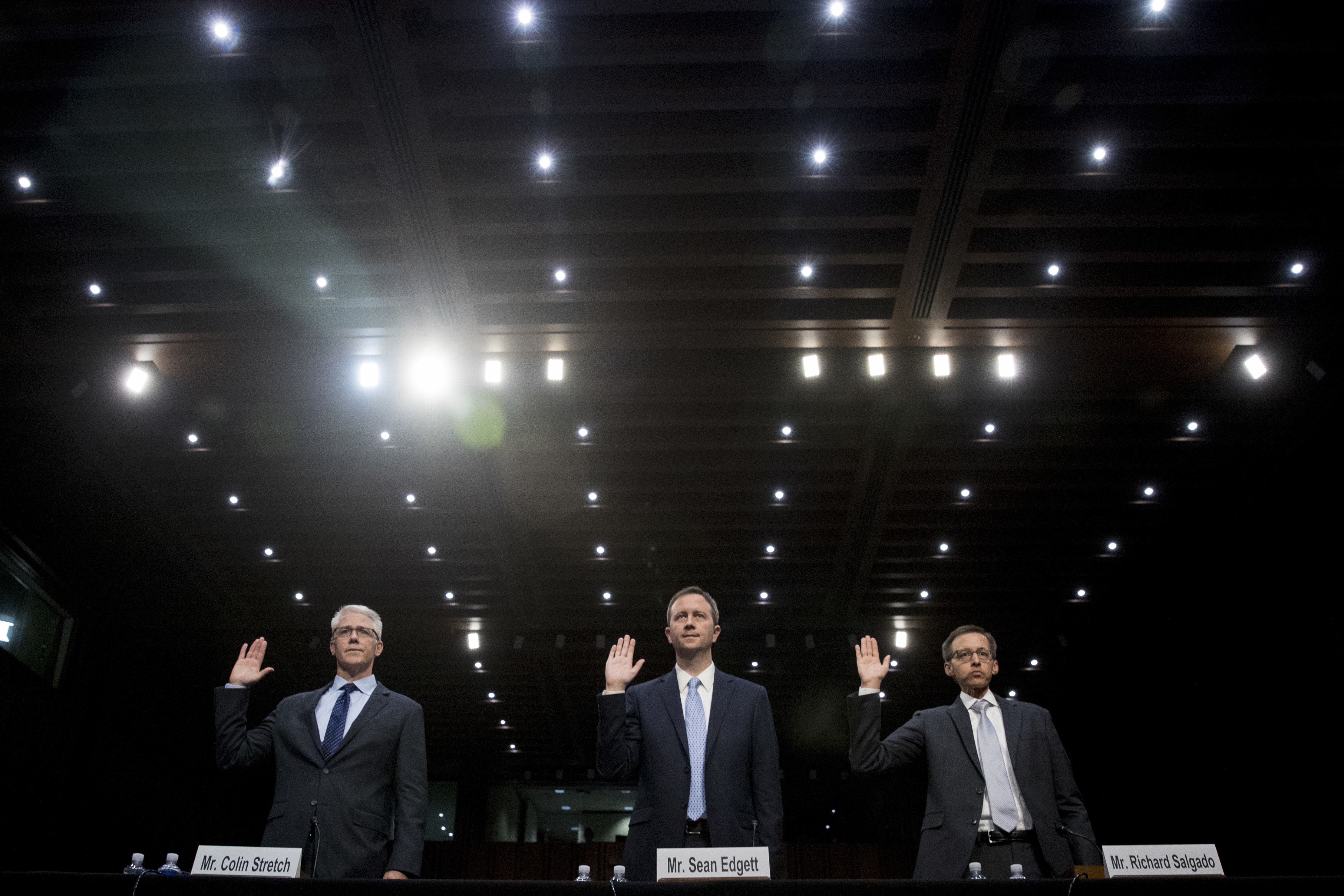 From left, Facebook's General Counsel Colin Stretch, Twitter's Acting General Counsel Sean Edgett, and Google's Law Enforcement and Information Security Director Richard Salgado, are sworn in for a Senate Committee on the Judiciary, Subcommittee on Crime and Terrorism hearing on Capitol Hill in Washington, Tuesday, Oct. 31, 2017, on more signs from tech companies of Russian election activity. (AP Photo/Andrew Harnik)