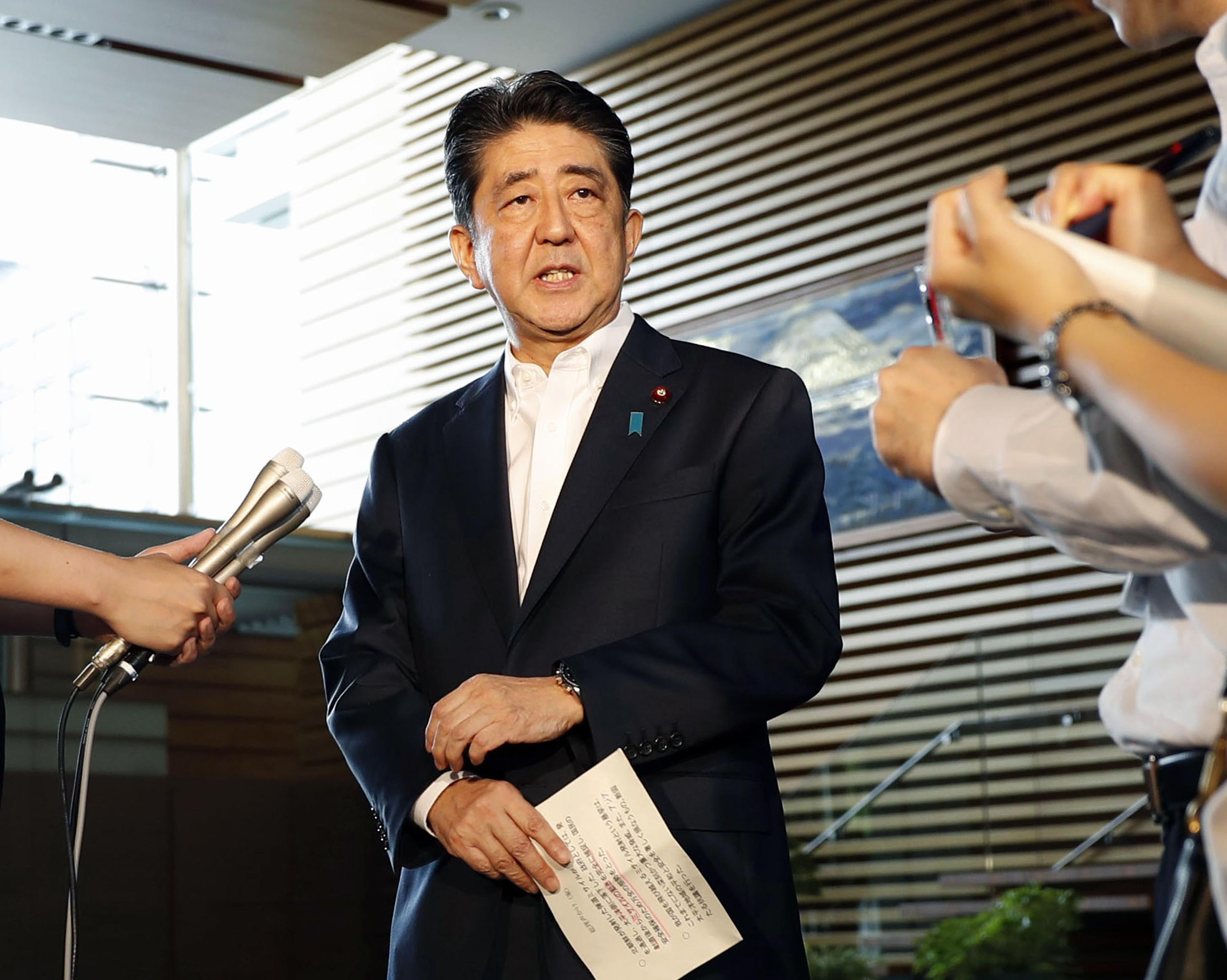 Japanese Prime Minister Shinzo Abe speaks to journalists at his official residence in Tokyo after North Korea's firing of a projectile over Japan Tuesday, Aug. 29, 2017.  (Kyodo News via AP)