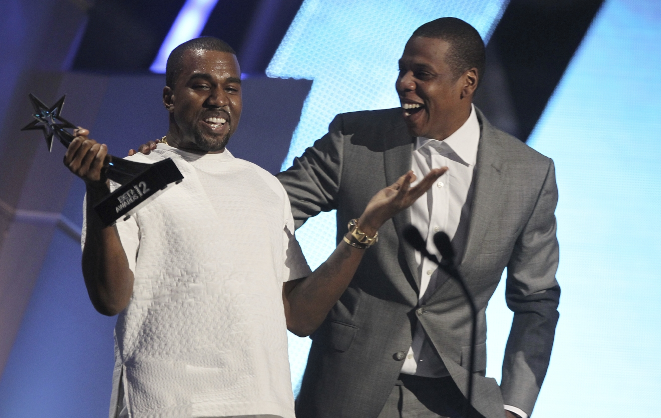 "FILE - In this July 1, 2012, file photo, Kanye West, left, and Jay-Z accept the award for best group for ""The Throne"" at the BET Awards in Los Angeles. (Photo by Matt Sayles/Invision/AP, File)"