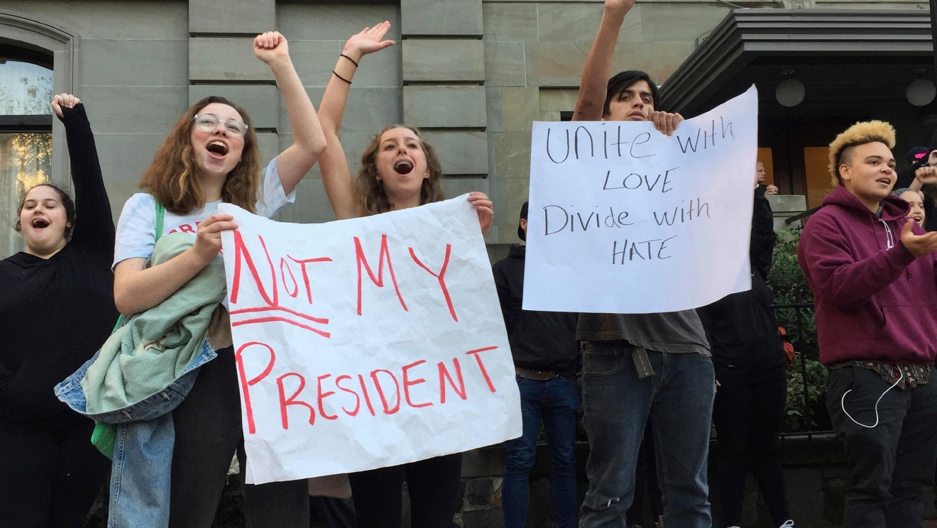 Several dozen students from various high schools in the Portland, Ore., metropolitan area gather downtown to protest Republican nominee Donald Trump's victory in Tuesday's presidential election, Wednesday, Nov. 9, 2016. The protests were peaceful and students said that they felt compelled to demonstrate against Trump because they were not old enough to vote. (AP Photo/Gillian Flaccus)