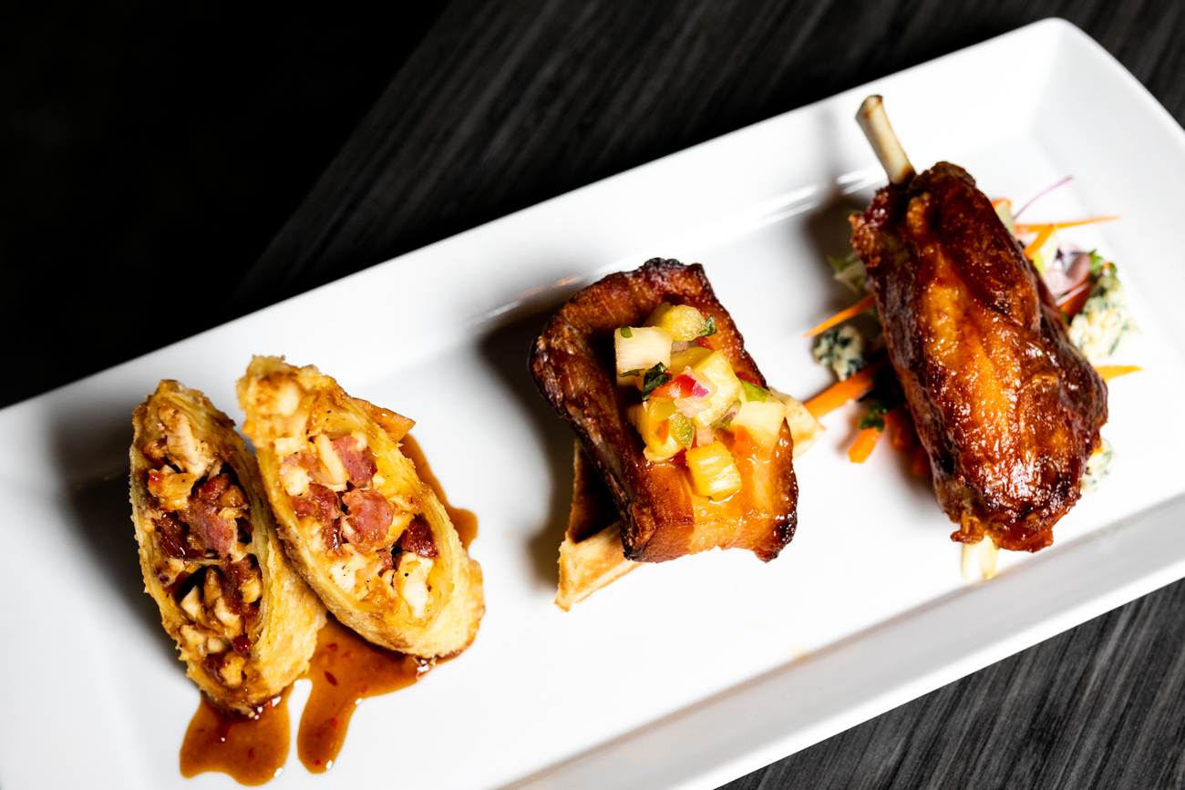 Galla Park Shareables: smoked chicken and andouille sausage spring roll, pork belly and waffles, and braised pork wing / Image: Amy Elisabeth Spasoff // Published: 11.28.18