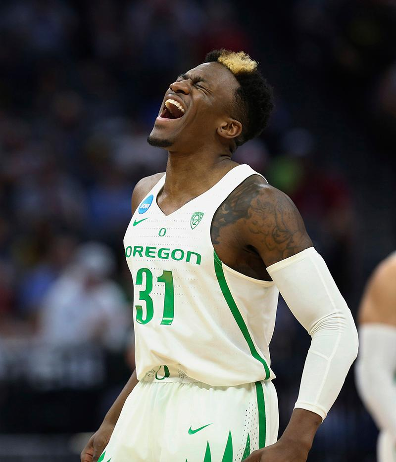 Oregon guard Dylan Ennis celebrates after the team scored during the first half against Rhode Island in a second-round game of the NCAA men's college basketball tournament in Sacramento, Calif., Sunday, March 19, 2017. (AP Photo/Steve Yeater)