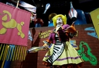 A Ringling Bros. and Barnum & Bailey clown juggles for fans during a pre show for fans Saturday, Jan. 14, 2017, in Orlando, Fla.