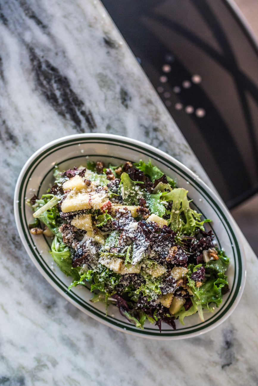 Apple Pecan Salad: Arcadian lettuce mix, honey crisp apple, bourbon candied pecans, parmigiano reggiano, and topped with honey mustard vinaigrette / Image: Catherine Viox // Published: 7.12.19