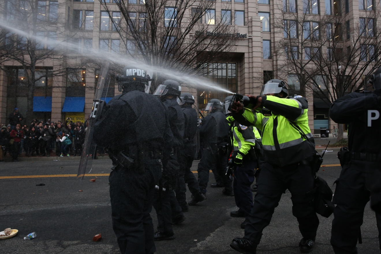 Police releasing tear gas onto a crowd of Disrupt J20 protestors. (Amanda Andrade-Rhoades/DC Refined)
