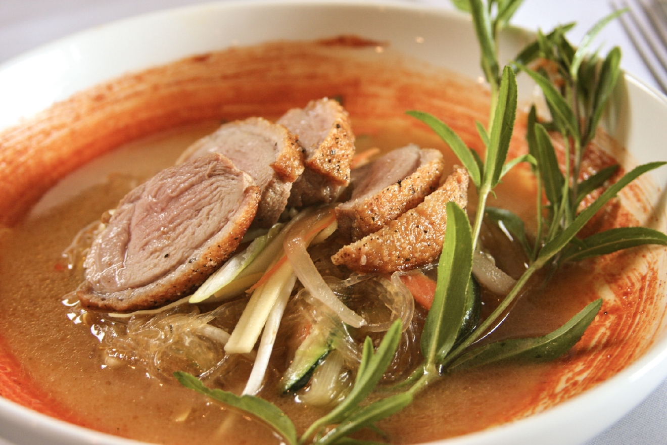 Duck:  Crispy skin duck breast, julienne vegetable, bean thread noodles, sesame miso broth, gochujang / Image: Molly Paz