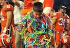 Young Clemson fan wraps himself in streamers and confetti after the Tigers' 30-3 win over Notre Dame in the Cotton Bowl. (Daren Stoltzfus, WCIV)