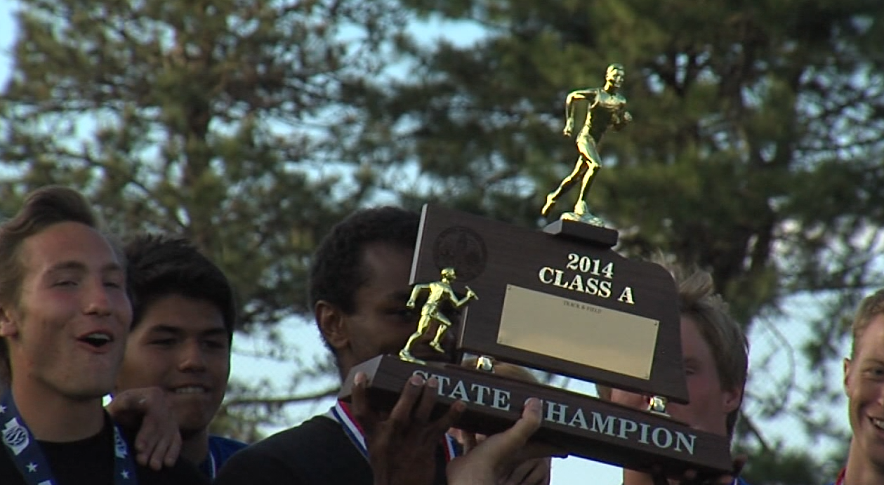 The 2014 Kearney High Boys Track team celebrates their state championship. (KHGI){&amp;nbsp;}<p></p>