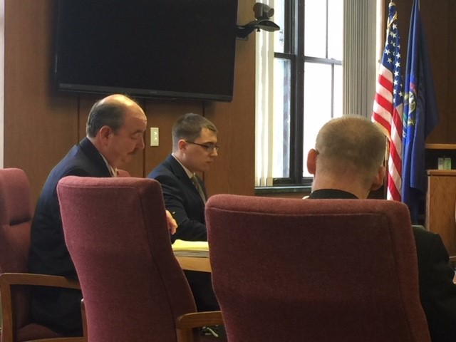 Brendon Clevenger, center, sitting with his attorneys in Kalamazoo County Circuit Court, pleaded guilty Thursday, Dec. 14, 2017, to a charge of reckless driving causing death in the crash that killed former Comstock Fire Chief Ed Switalski.  (WWMT/Jessica Wheeler)<p></p>