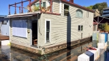 Crews work to rescue sinking floating home on Columbia River
