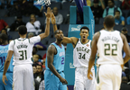 Milwaukee Bucks forward Giannis Antetokounmpo (34) high fives teammate John Henson (31) after a score against the Charlotte Hornets during the first half of a game, Wednesday, Nov. 1, 2017, in Charlotte, N.C.