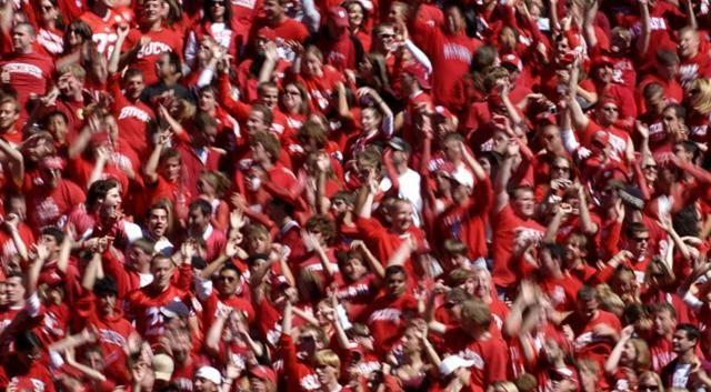 "80,000 fans jumping and screaming to ""Jump Around"". The tradition started in 1998 following a Badger victory."