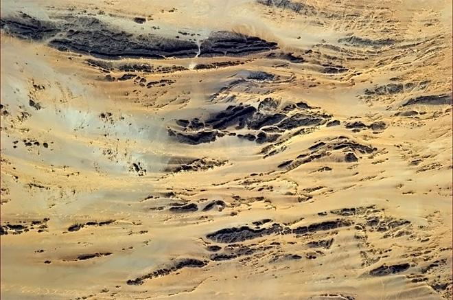 Like the sand came crashing over the shore of rock. (Photo & Caption: Chris Hadfield/NASA)