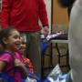 United Healthcare show their generosity by donating 600 coats to Unity Elementary
