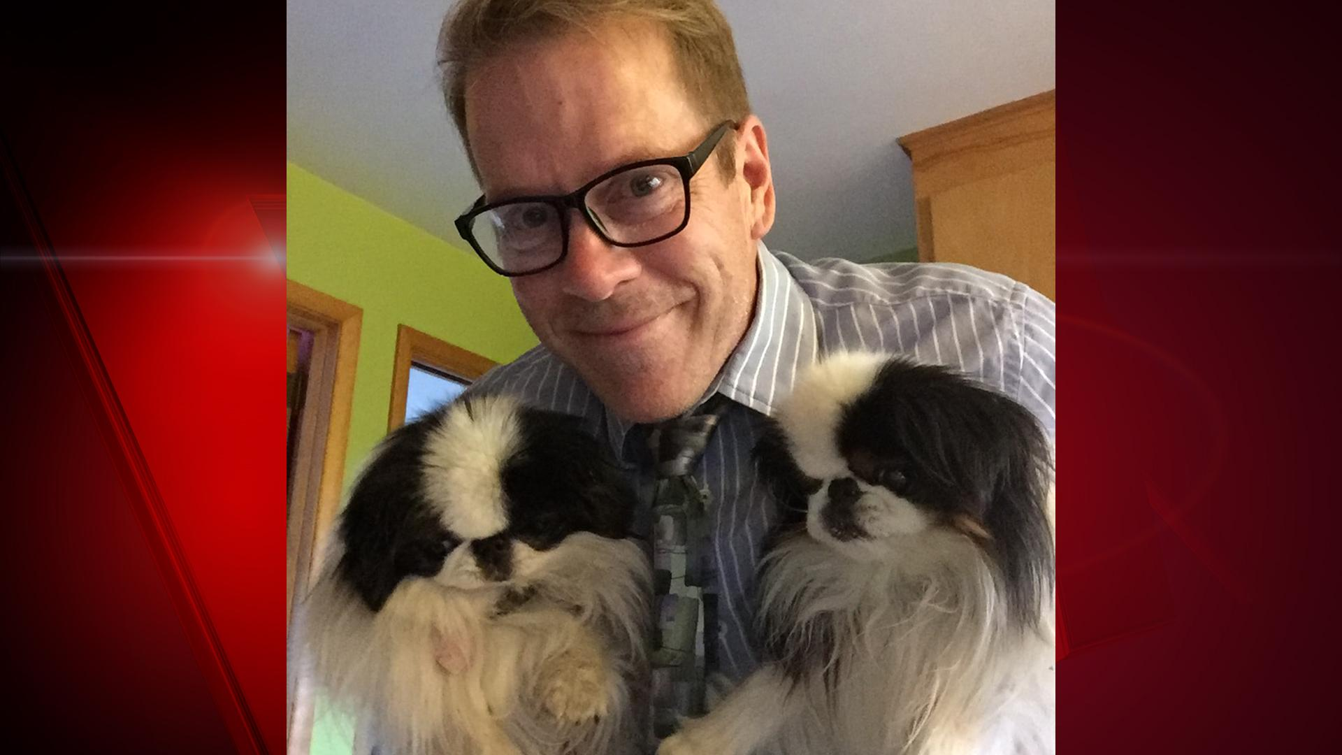 "Meet FOX 11 Investigates reporter/anchor Mark Leland's dogs. Both 7-year-old Kiki and 8-year-old Mushu are Japanese Chins. Mark says, ""They're like puppies that never grow up, weighing about 7 pounds each."" (WLUK/Mark Leland)"