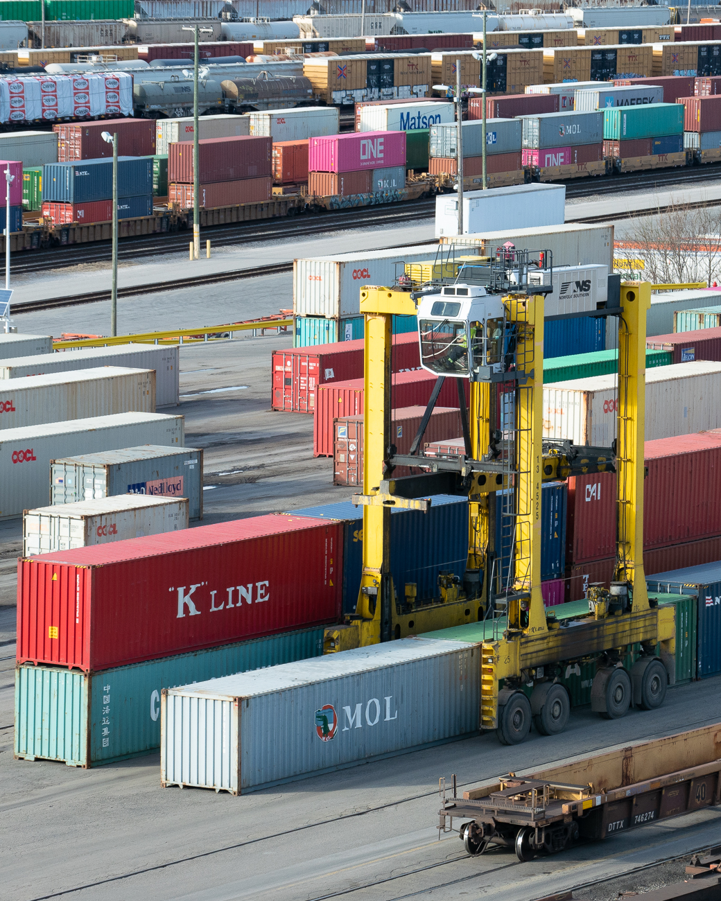 Kalmar Straddle Carriers lift and stack shipping containers in the rail yard. They're visible from Tower A. / Image: Phil Armstrong, Cincinnati Refined // Published: 1.17.20