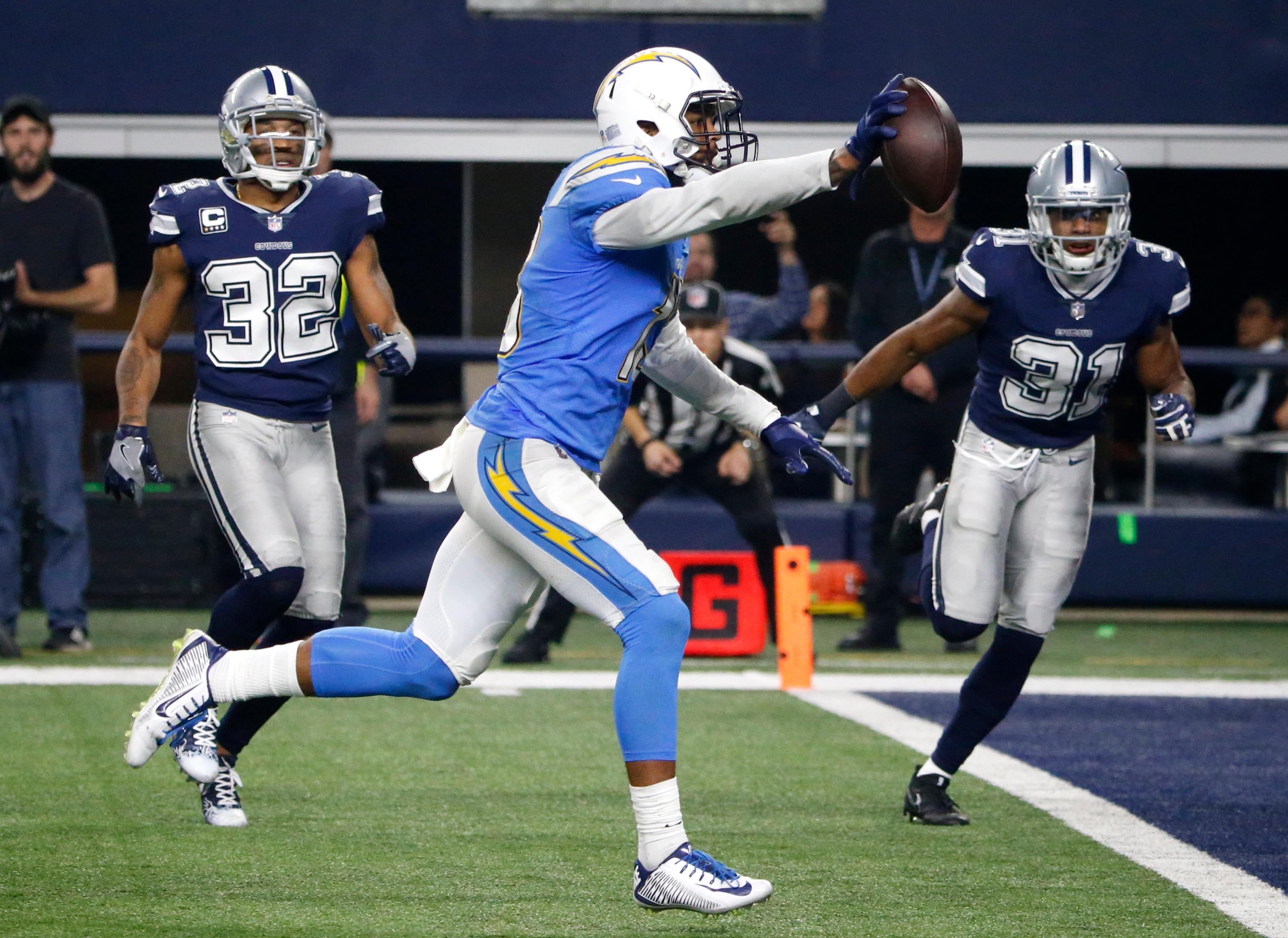 Los Angeles Chargers wide receiver Keenan Allen (13) sprints to the end zoned in front of Dallas Cowboys' Orlando Scandrick (32) and Byron Jones (31) for a touchdown in the second half of an NFL football game, Thursday, Nov. 23, 2017, in Arlington, Texas. (AP Photo/Michael Ainsworth)