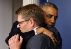 President Barack Obama gives White House press secretary Jay Carney a hug after announcing that Carney will step down later next month, during a surprise visit to the Brady Press Briefing Room of the White House, Friday, May 30, 2014. The president announced Carney's departure in a surprise appearance at in the White House press briefing room Friday. He said principal deputy press secretary Josh Earnest will take over the job. (AP Photo/Susan Walsh)