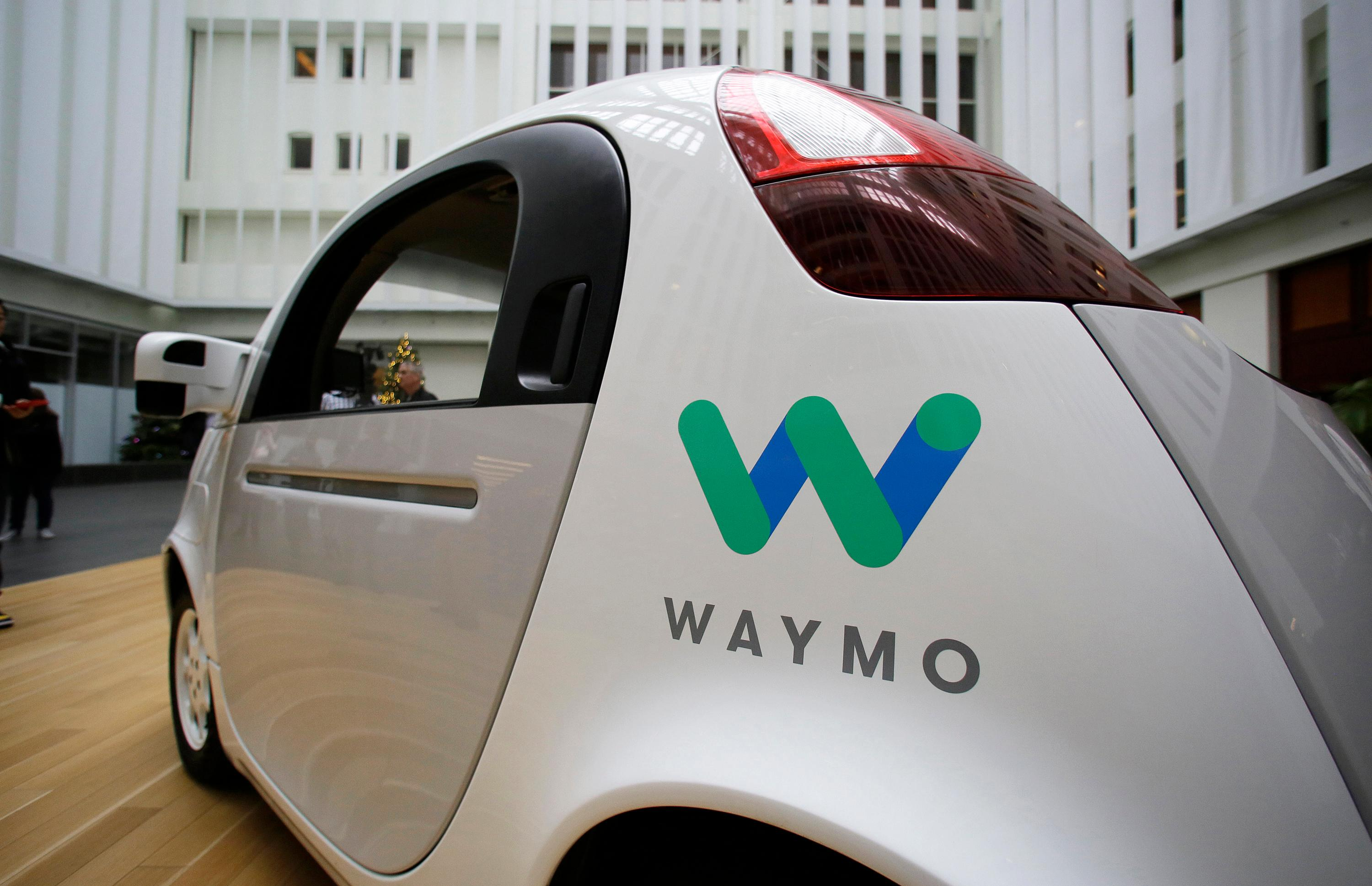 FILE - In this Tuesday, Dec. 13, 2016, file photo, the Waymo driverless car is displayed during a Google event in San Francisco. A federal criminal investigation into alleged espionage at Uber has indefinitely delayed a trial over whether the beleaguered ride-hailing service stole self-driving car technology from Waymo, a spinoff from Google. (AP Photo/Eric Risberg, File)