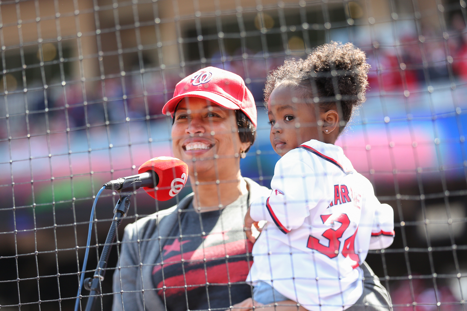 "D.C. Mayor Muriel Bowser was joined by 2-year-old Parker Curry to say ""play ball"" and commence the game. Curry went viral after a photo of her gazing at a portrait of Michelle Obama was posted online. (Amanda Andrade-Rhoades/DC Refined)"