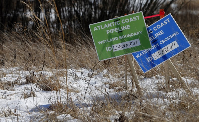 <p>Signs mark the route of the Atlantic Coast Pipeline in Deerfield, Va., Thursday, Feb. 8, 2018. Work is progressing on clearing a path for the pipeline. (AP Photo/Steve Helber)</p>