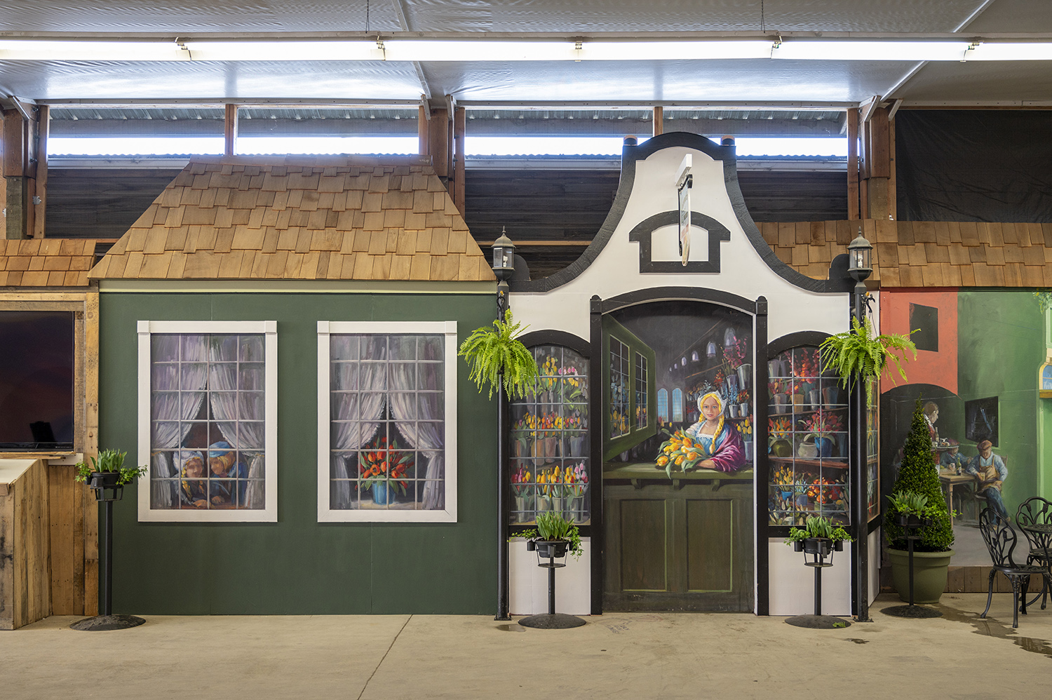 Local artist and 2020 tulip poster artist, Jennifer Bowman, created the beautiful murals inside Tulip Town's bulb market. Her artwork is just as beautiful as the blooms outside. (Rachael Jones / Seattle Refined)