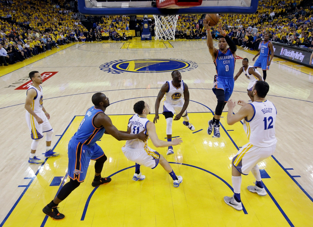 Oklahoma City Thunder's Russell Westbrook (0) drives to the basket against the Golden State Warriors during the first half in Game 2 of the NBA basketball Western Conference finals Wednesday, May 18, 2016, in Oakland, Calif. (AP Photo/Marcio Jose Sanchez)
