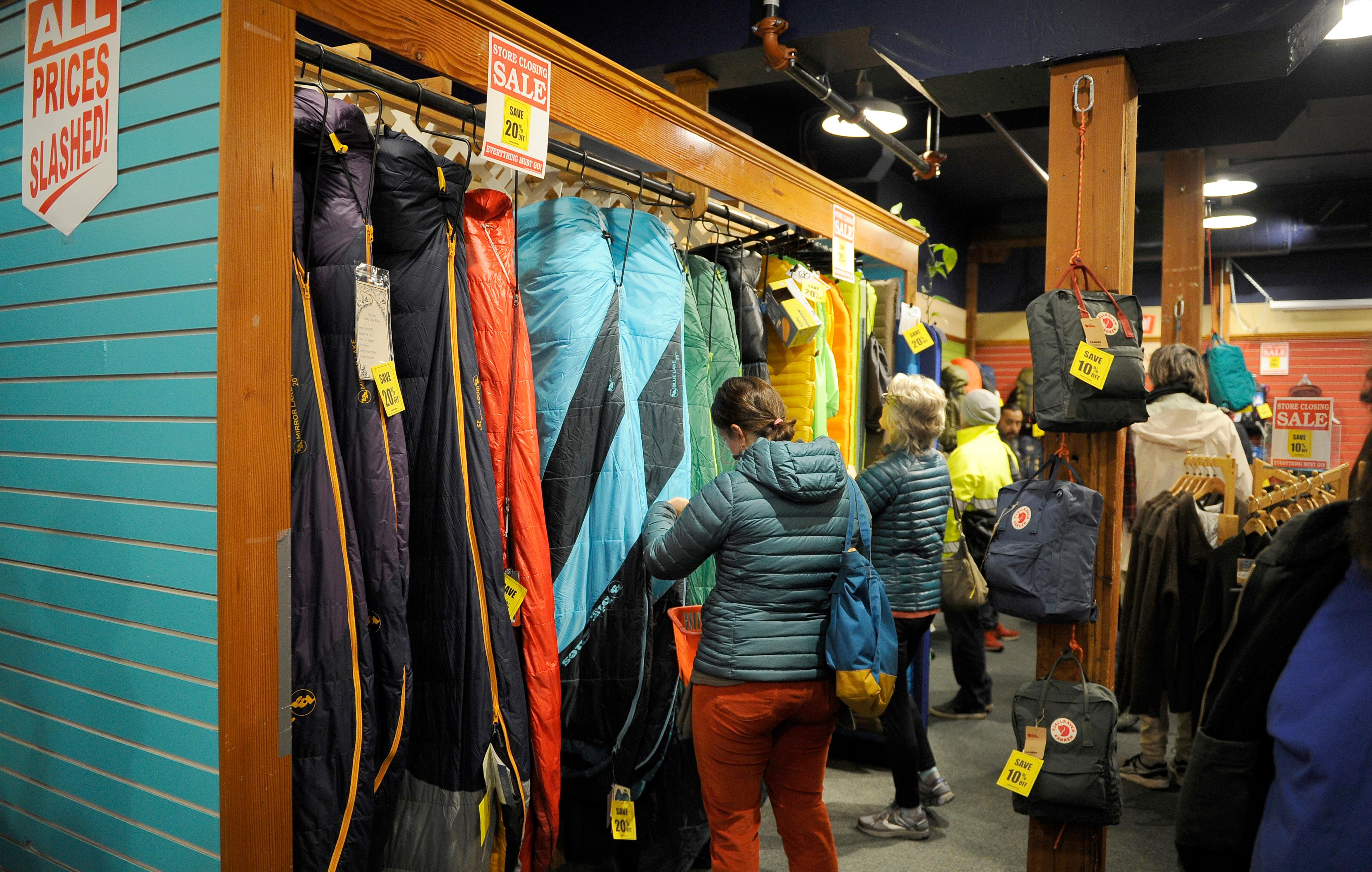 Andy Atkinson / Daily Tidings<br>Customers look through sleeping bags during the Ashland Outdoor Store's liquidation sale Wednesday morning.
