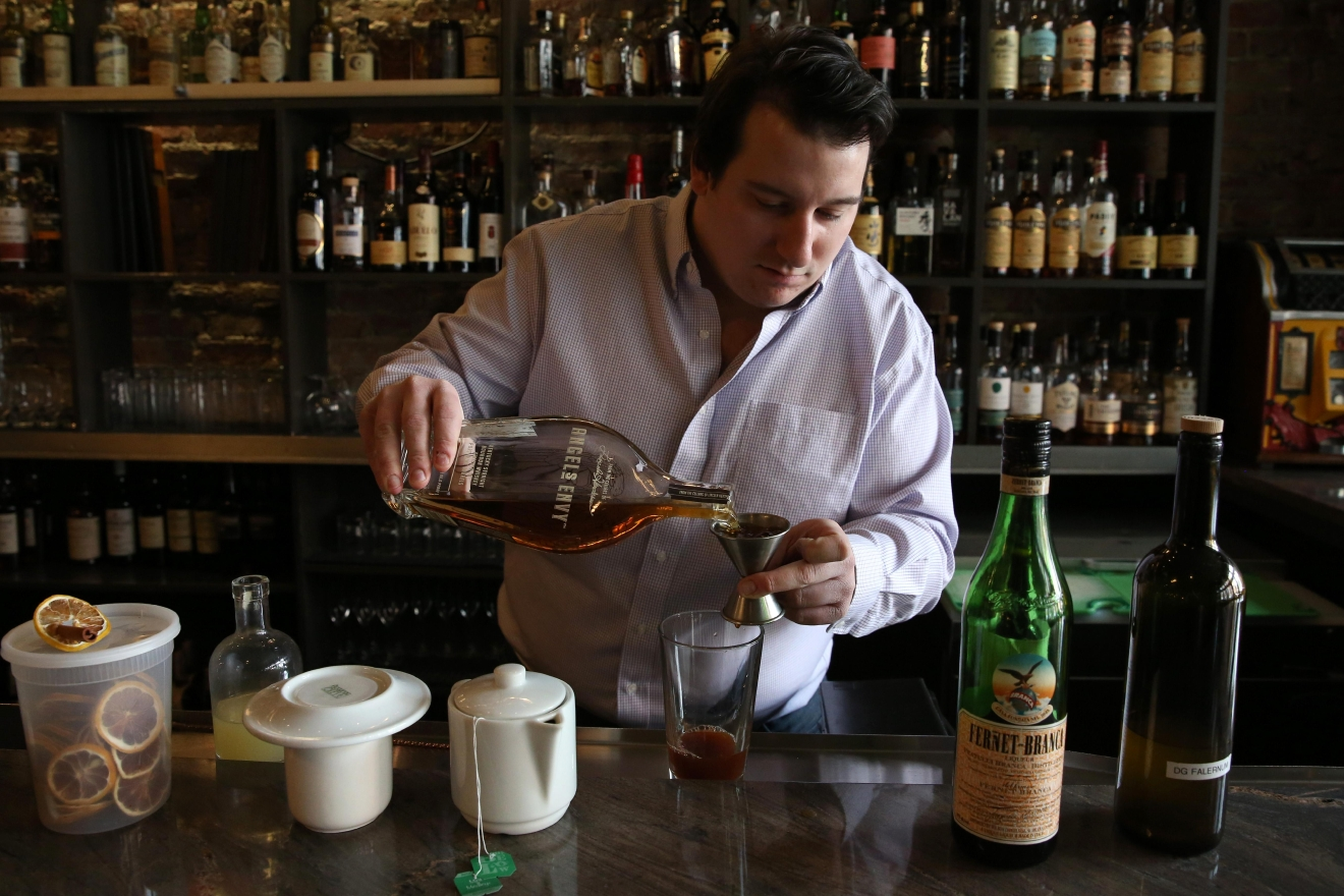 Barton's drink, which doesn't have an official name, leans heavily on bourbon. He also incorporated spice-heavy falernum, fernet, mint tea, bitters, sugar and lemon juice. (Amanda Andrade-Rhoades/DC Refined)